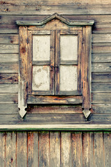 Old window in a wooden house