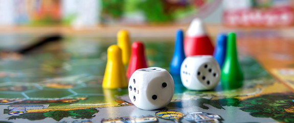concept of board games. Dice, chips and cards on a green background long banner