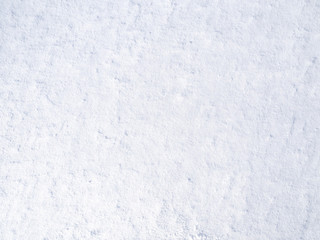 texture of white fresh snow sparkling in the sun, natural winter background
