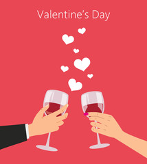Man and woman with red wine glasses. Valentine's day concept.
