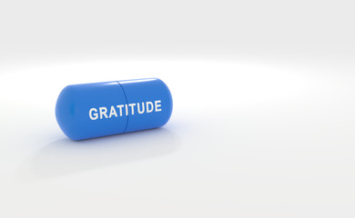 Gratitude pill isolated on white