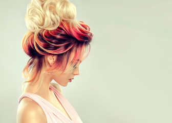 Foto auf Acrylglas Friseur Beautiful model girl with elegant multi colored hairstyle . Stylish Woman with fashion hair color highlighting. Creative red and pink roots , trendy coloring.