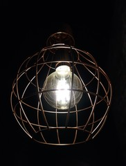 lamp lit inside a metal luminaire