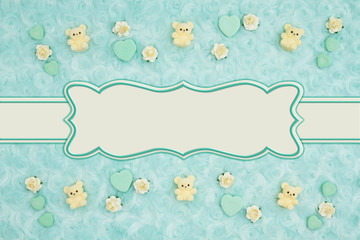 Teal candy hearts and rose buds on pale teal plush fabric background