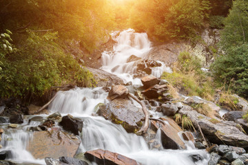 Closeup view waterfall scenes in mountains, national park Caucasus, Russia
