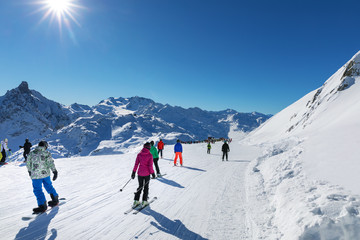 people on sunny slope at 3 valleys ski resort in Alps, France