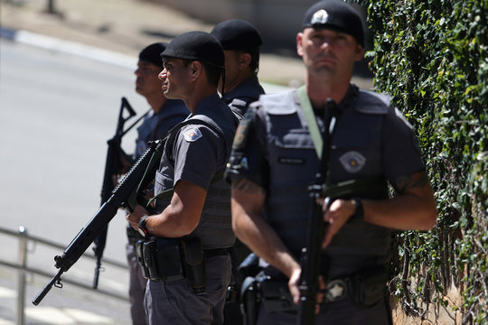 Policemen stand in front of Albert Einstein Hospital after a convoy of vehicles transporting Brazil's President Jair Bolsonaro arrived at the hospital for a surgery, in Sao Paulo