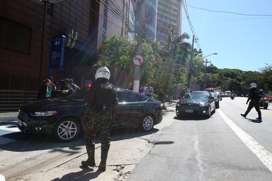 A convoy of vehicles transporting Brazil's President Jair Bolsonaro arrives at Albert Einstein Hospital in Sao Paulo