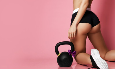 Perfect fitness girl ass buttocks after working out with big weight dumbbell sport work out concept...