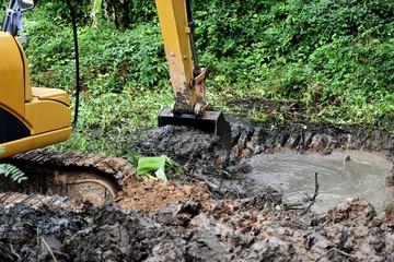 backhoe dig ground