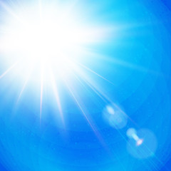 Vivid Sunburst with radiating rays in a clear blue sky.