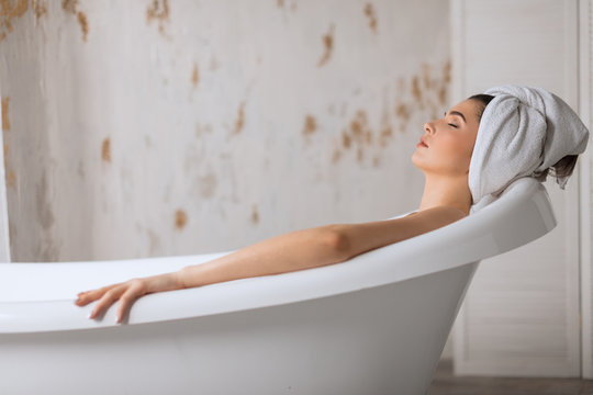 Relaxing caucasian woman getting spa treatment at beauty salon, taking bath.