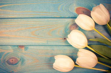 A bouquet of white tulips with a frame for inscription.
