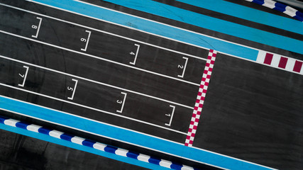 Grid race start line in a car track, Aerial top view of grid race start.