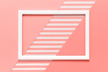 Abstract geometrical living coral pantone color flat lay background. Minimalism, geometry and symmetry template with empty picture frame mock up.