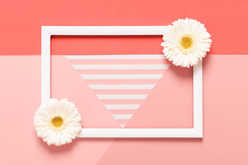 Happy Mother's Day, Women's Day, Valentine's Day or Birthday Living Coral Pantone Color Background. Flat lay mock up greeting card with beautiful gerbera flowers and picture frame.