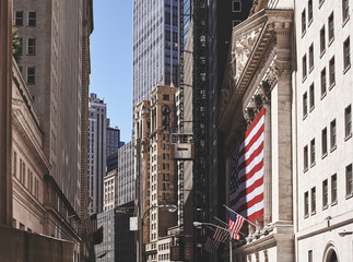 Retro toned picture of Wall Street architecture, New York City, USA.