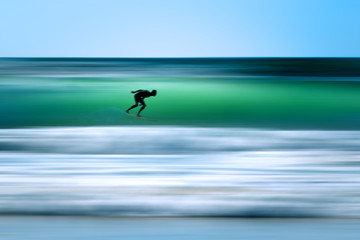 Surfer in a wave