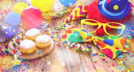 Colorful carnival or party background with donuts, balloons, streamers and confetti and funny face