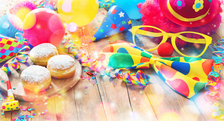 Spoed Fotobehang Carnaval Colorful carnival or party background with donuts, balloons, streamers and confetti and funny face