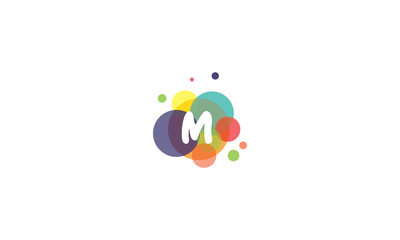 Bright and colorful image of the letter M, against the background of multicolored circles.