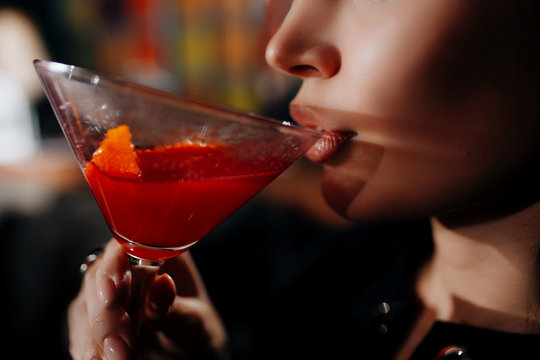 young girl drinking red lip cocktail close up