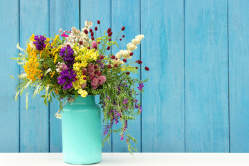 Bouquet of wild flowers in starm tin can vase on background blue wooden boards. Template for postcard Copy space lettering text or design Concept Women's day, Mothers Day, Hello summer or Hello spring Fototapete