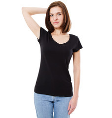 Blank black t-shirt design mockup. Women stand near wal in black tshirt clear template front mock up. Empty female apparel uniform singlet model, dress surface ready for print.