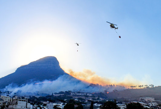 Fire helicopters  fighting a growing wildfire on the 27th of January 2019 at Lion's Head in Cape Town, South Africa