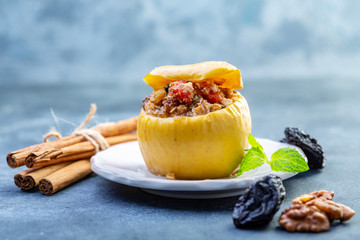 Baked apple stuffed with oatmeal, raisins and nuts.