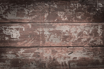 Old painted brown wooden background close up
