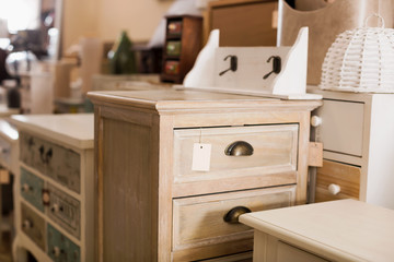 Furniture showroom with wooden chest of drawers