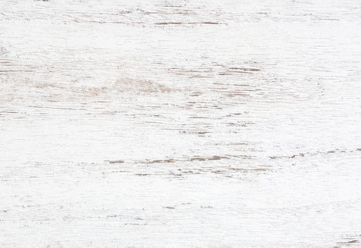Grunge background. Peeling paint on an old wooden table. White wooden texture for background.  Top view.