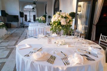 restaurant terrace prepared for a wedding dinner