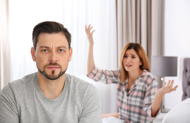 Couple having argument in bedroom. Relationship problems