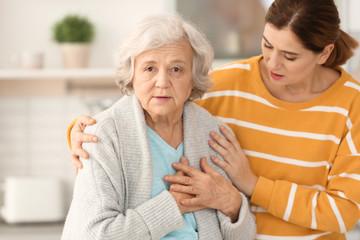 Elderly woman with female caregiver in kitchen