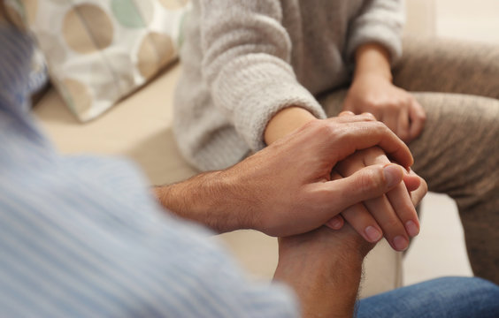 Man comforting woman, closeup of hands. Help and support concept
