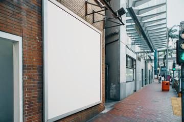 Train station with empty white billboard