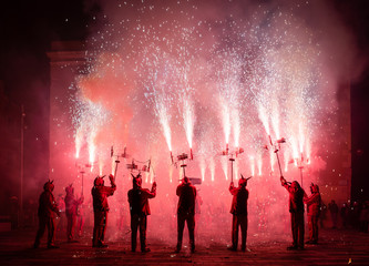 Typical Correfocs of Catalonia, a type of fireworks managed by men dressed as devils
