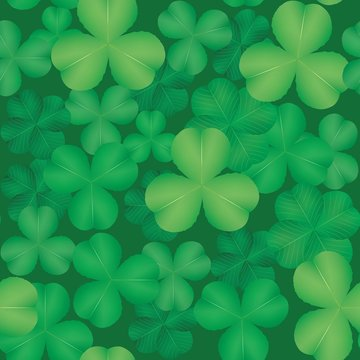 Seamless pattern with green leaves of clover. Vector illustration.