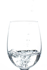 A glass of water on a white background. Close-up