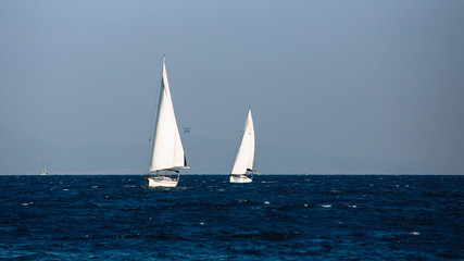 Wall Mural - Yacht with white sails in the Aegean sea. Sailing.