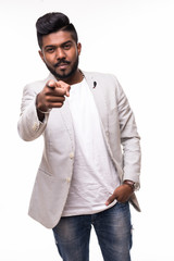 Excited bearded indian hipster man in checkered shirt pointing fingers at camera isolated on a white background
