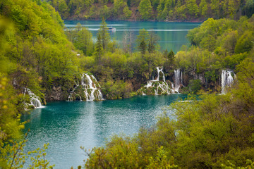 View of majestic waterfalls, cascade arranged lakes and green forests, Plitvice Lakes National Park, Croatia