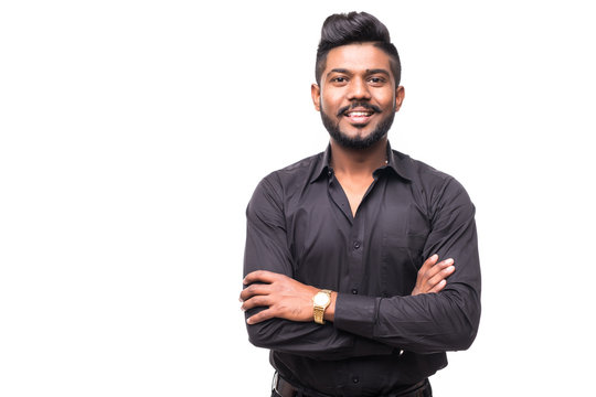 Portrait of happy young indian hipster businessman with crossed hands isolated on white background