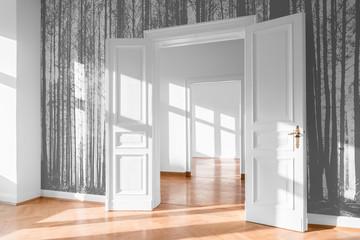 open room door in bright flat with photo wallpaper -