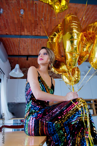Young Woman With Golden Balloons On Her Thirty Years Birthday Indoor Location Person Is