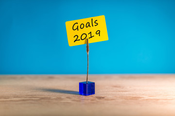 2019 goals on tag at blue abstract background and empty space for text, mock up