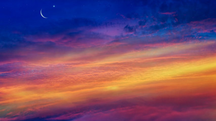 Crescent moon with beautiful sunset background . Generous Ramadan . Light from sky . Religion background .