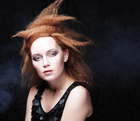 redhair woman in smoke